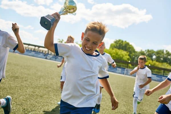 Boy Holding Trophy Cup